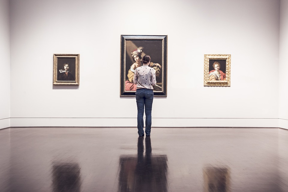 woman looking at an art collection