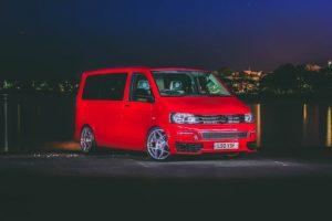 A red van at night