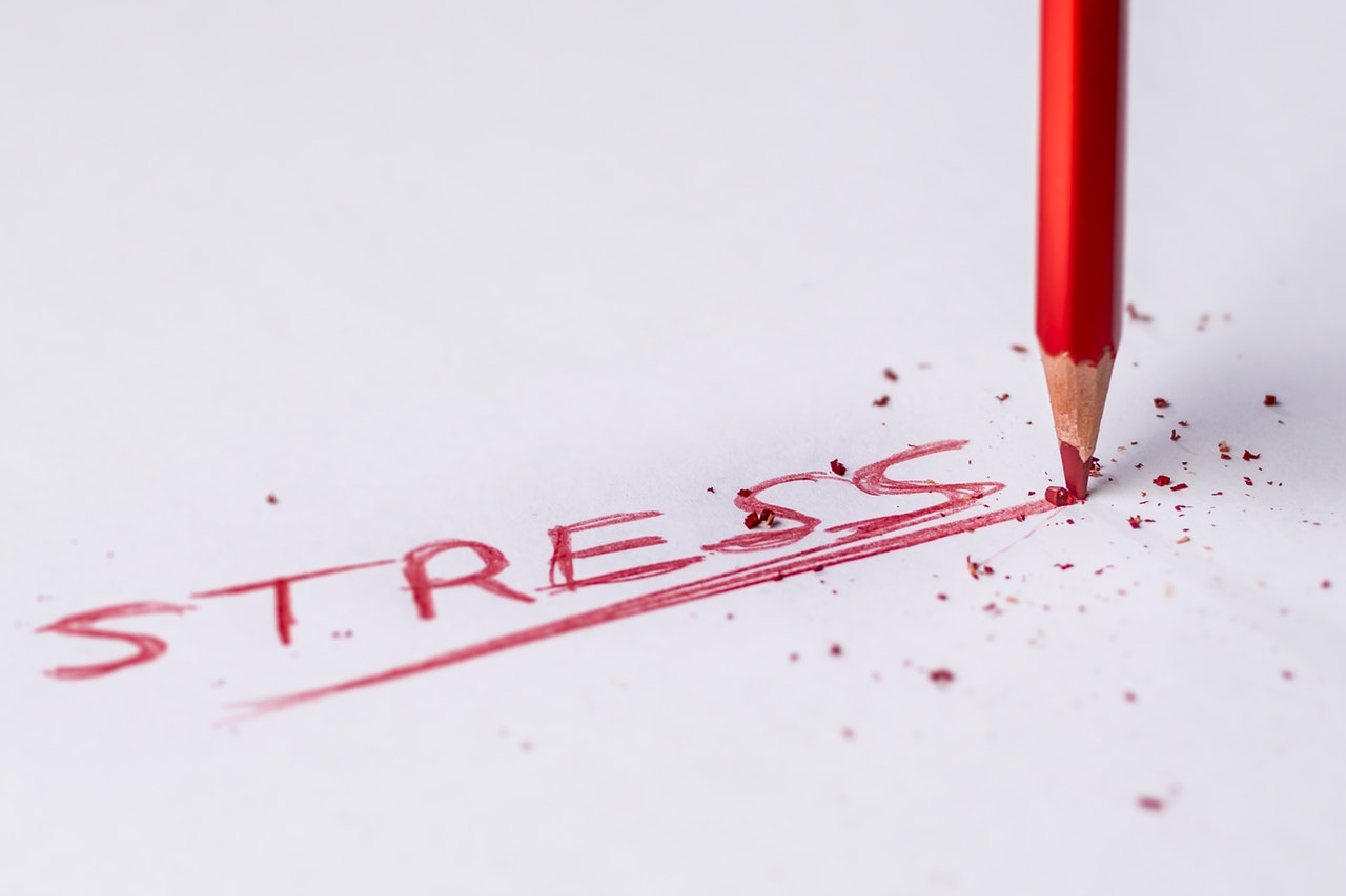 The word stress written in red. Stress can be very harmful that's why it is important to learn how to cope with moving stress when relocating.