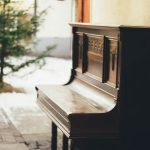 A piano next to a wall