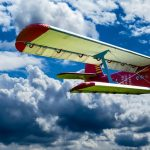 The advantages and downsides of air freight shipping with a red-yellow plane in the sky.