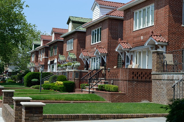 Adjusting to life in the suburbs, houses made of red brick with gardens.