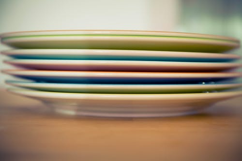 Plates in different colors are on of the packing dishes for moving
