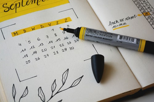 Planner with calendar and marker