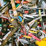 A pile of knives, scissors and other tools