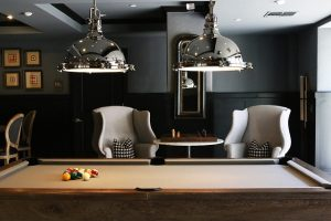A pool table inside a home.