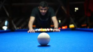A man playing pool.