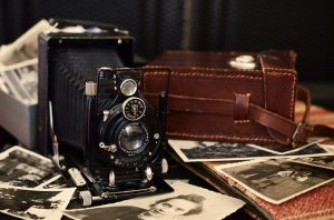 Keep photographs separate when storing family heirlooms.
