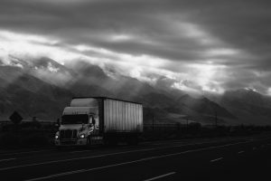 Moving truck with clouds above