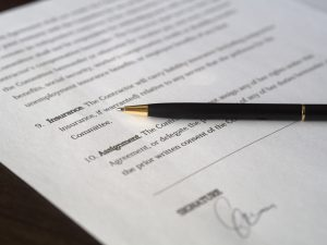a pen and a contract
