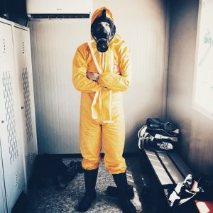 Man dressed in a protective suit for packing hazardous materials