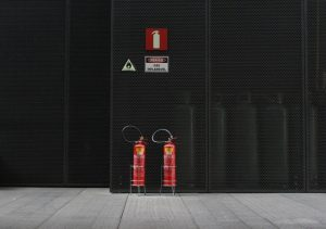 Two fire extinguishers on a black background