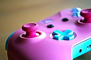 X box Console in pink and blue