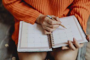 girl looking at a calendar
