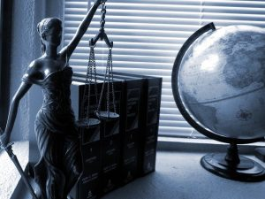 Lady justice, books and a globe