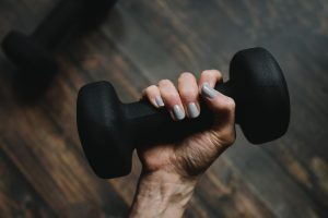 person holding a dumbell