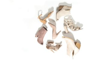 Mismatched tan shoes.