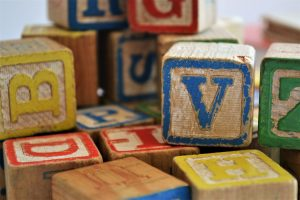 Alphabet blocks that you need to put away when you pack toys for storage.