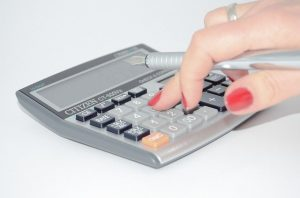 A hand using calculator