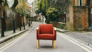 An chair on the street waiting for furniture movers