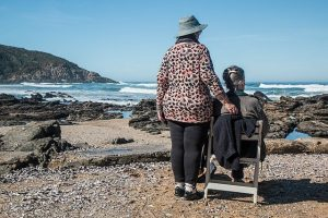 Elderly sitting at the beach