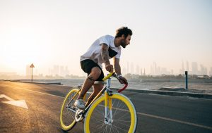 a man riding a yellow bike
