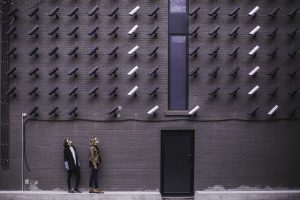Two females looking at cameras on the wall