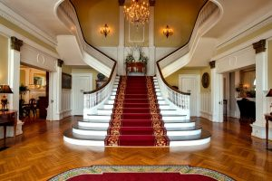 one of the best guideliness for relocating hotels is certainly having the right number of movers. grand staircase of a mansion