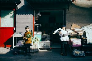 Two kids carrying items