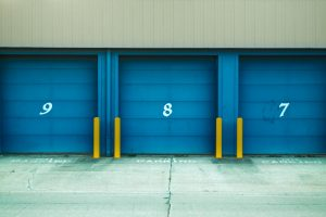 storage units with blue doors and numbers 7, 8, and 9 written on them