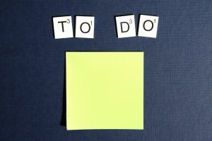 make a checklist when moving to New York City. a post it scrabble and the words to do.