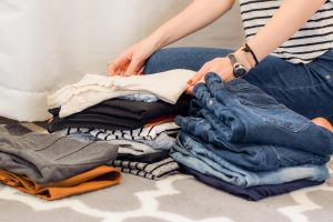 person folding clothes
