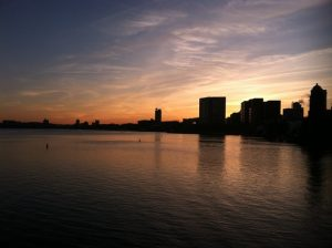 view of Boston from the river at sunset