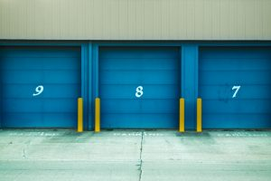 storage units` doors painted in blue and numbered 9, 8, and 7