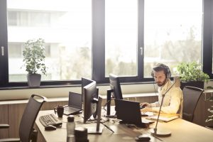 Man with headphones sitting in the office