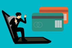 protect your business against fraud - theif stealing credit cards