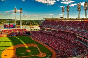 a photo of the great american ballpark during the game with a cheering crowd