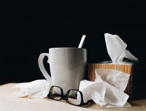 mug and tissues moving while sick