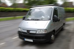 A grey van in motion