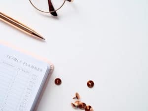 planner next to pen