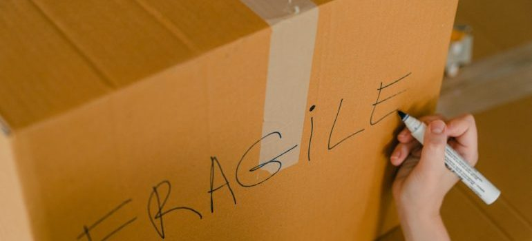 cardboard box for packing things as one of the most time-consuming relocation tasks