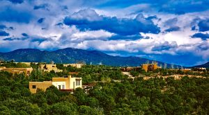 Santa Fe, greenery and a mountain on a clear day
