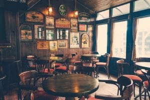 packing and moving a pub and chairs and tables inside