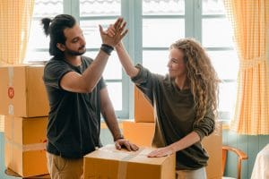 a man and a woman high fiving eachother after successfuly packing