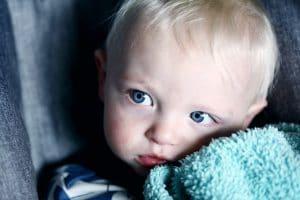 baby hugging a blanket