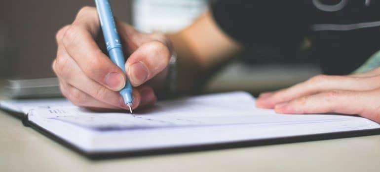 Man writing a plan.