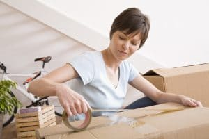 a woman packing boxes for moving to Memphis