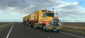 a yellow moving company truck on the road