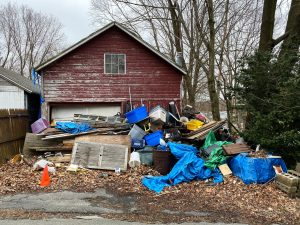 junk in front of a house