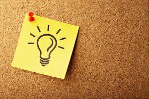 A drawn light bulb on a stick note